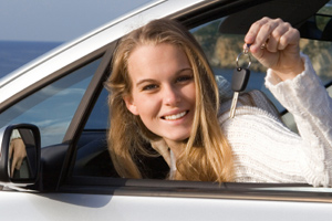 Girl who received car loan through Joliet Municipal Employees FCU